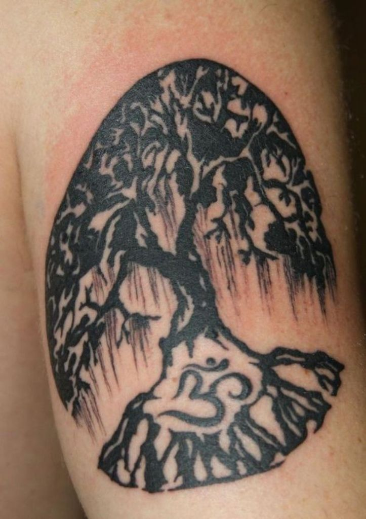Attractive Old Tree And Om Sign Tattoo In Root Design