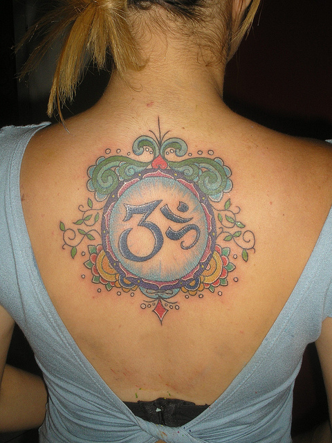 Colorful Lovely Om Sign Tattoo On Beautiful Girl Back Body