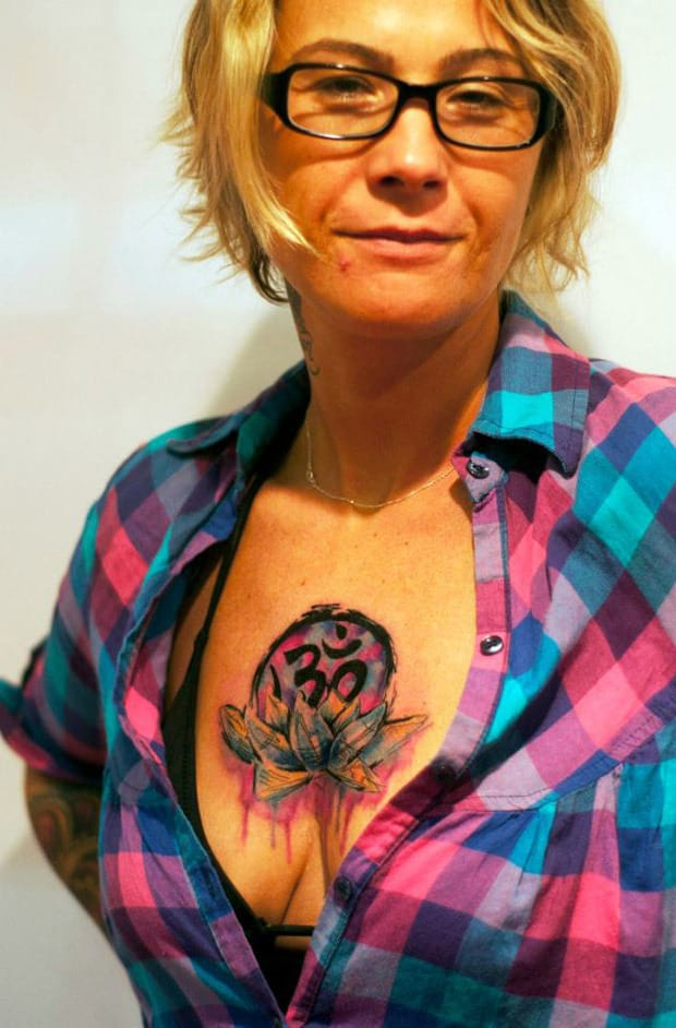 Colorful Om And Lotus Flower Tattoo On Women Chest