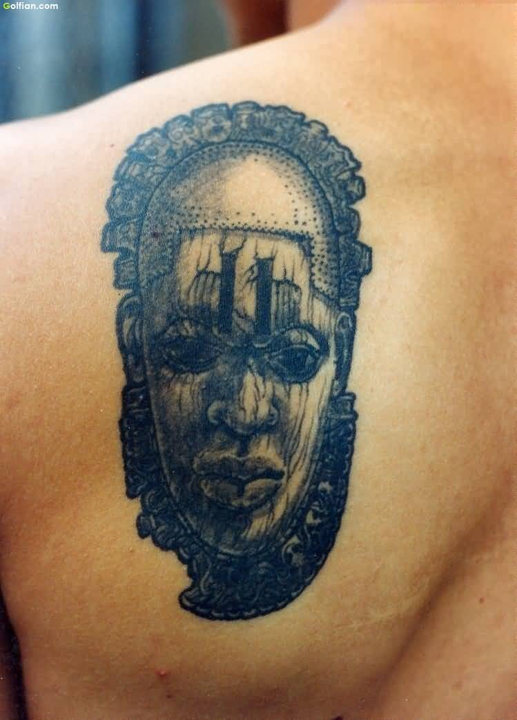 Attractive African Face Mask Tattoo On Back