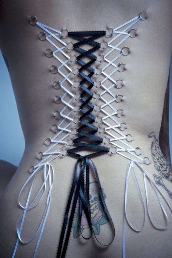 Awesome Black White Corset Highlight Piercing For Girl Back With Tattoos