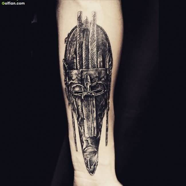 Black Ink Old African Mask Tattoo On Men Sleeve
