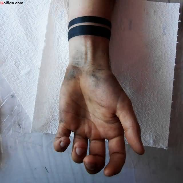 Black Ink Solid Armband Tattoo On Men Wrist