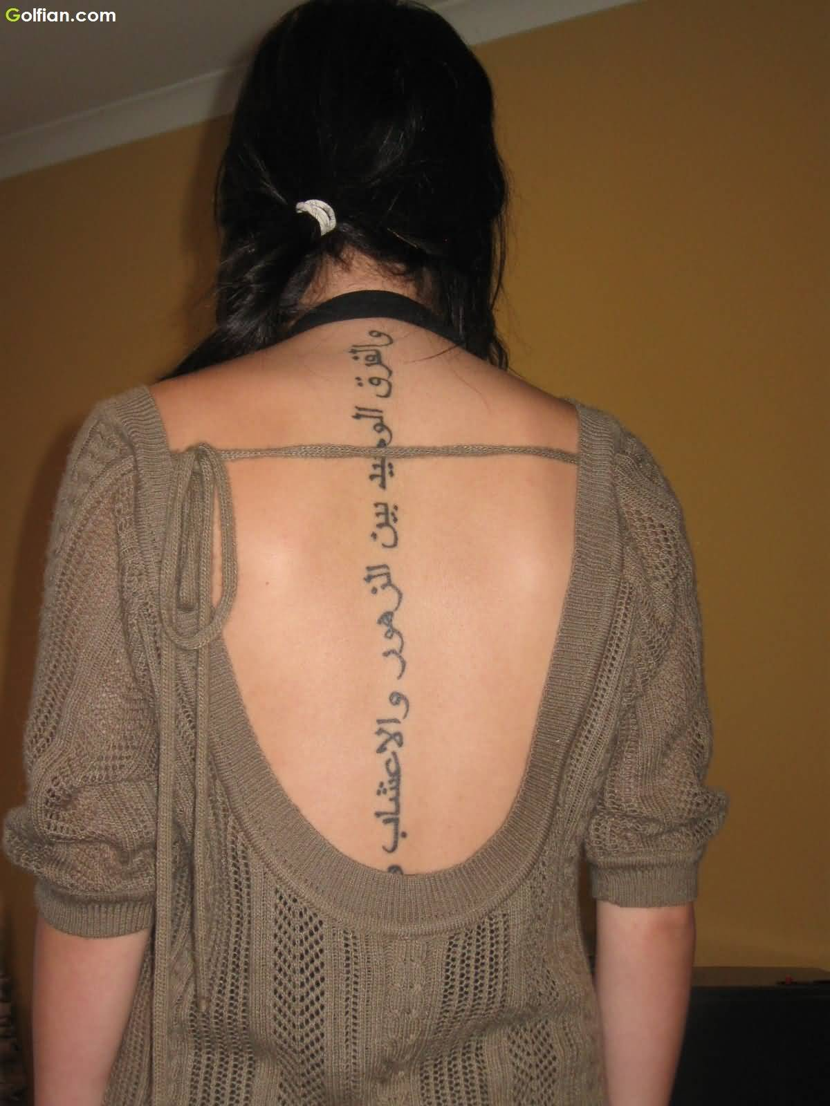 Beautiful Arabic Spine Tattoo Design For Cool Girl