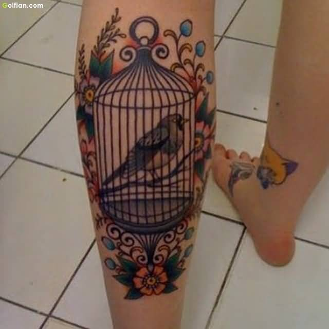 Brilliant Bird and Aqua Cage Tattoo Made On Women Calf