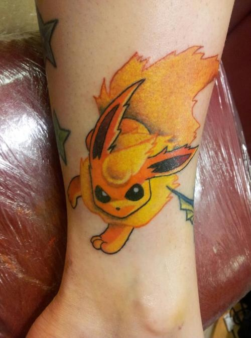 Cute Little Animated Poke Tattoo For Women Side Leg