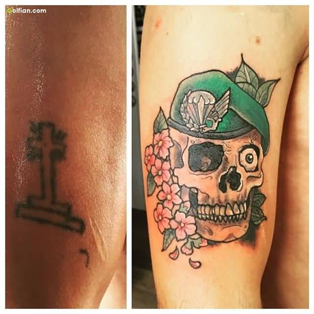Fantastic Army Skull With Flower Vine Tattoo On Men Upper Arm