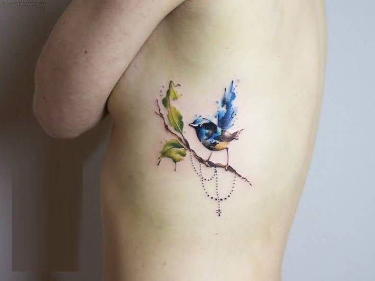 Mind Blowing Small Aqua Bird On Tree Tattoo Design For Women Ribs Side