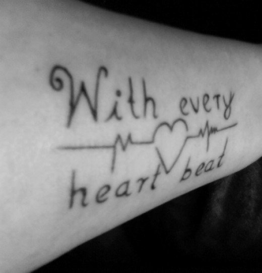 Most Fabulous Heartbeat Quote Love Tattoo Design On Sleeve