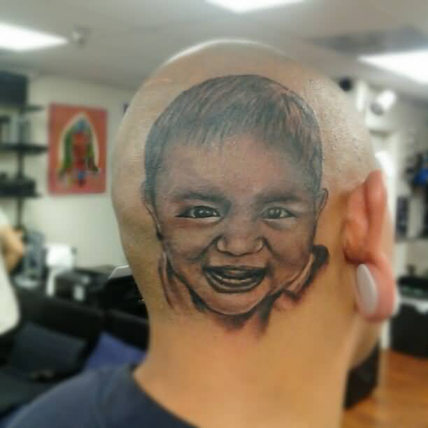 Outstanding Smiling Baby Face Tattoo Made On Men Head