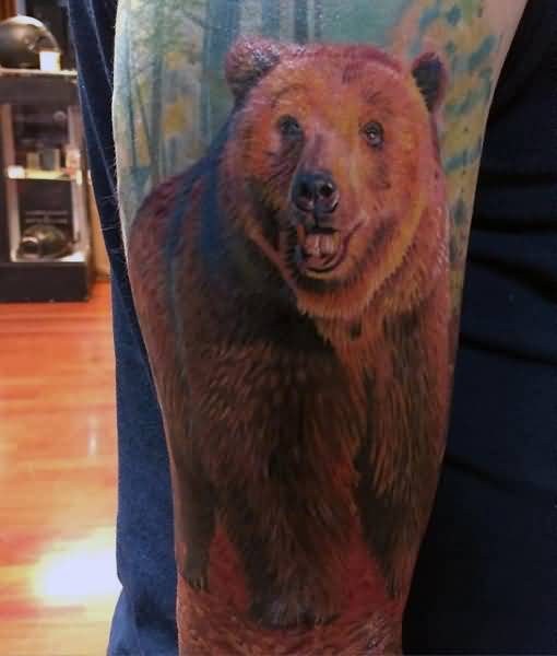 Aggressive Brown Bear Forest Tattoo Design On Men Upper Arm