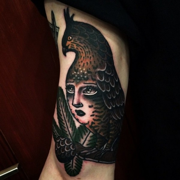 Awesome Bird And Girl Face Tattoo On Men Bicep