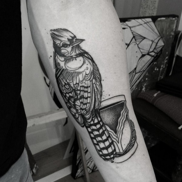 Awesome Black Ink Bird Tattoo On Men Lower Arm