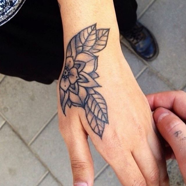 Awesome Half Flower And Leaf Tattoo Design On Girl Hand