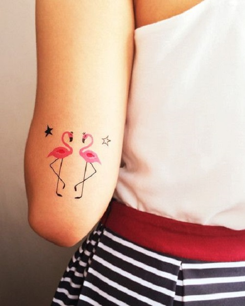 Awesome Pink Ink Flamingo Star Bird Tattoo On Back Arm