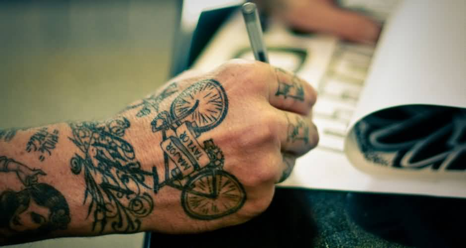 Awesome Small Bicycle Banner Tattoo Design For Men Hand