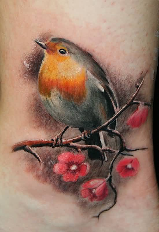 Cute Small Bird With Flower Tattoo On Leg
