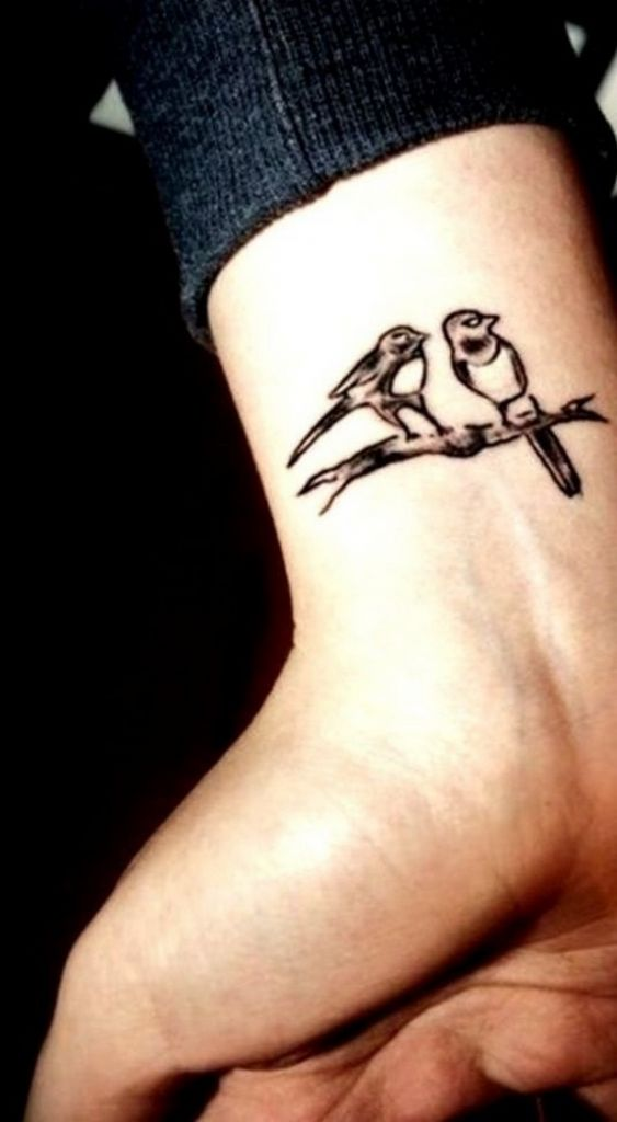 Cute Small Love Bird Sitting On Tree Tattoo On Wrist