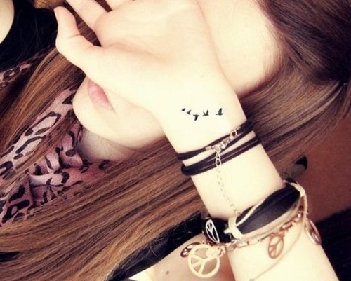 Girl Got Her New Flying Bird Tattoo Design On Wrist