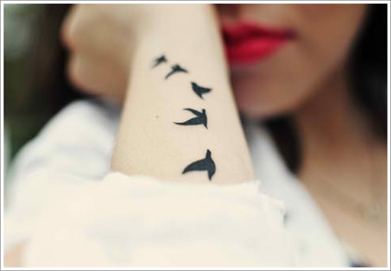 Impressive Black Bird Tattoo Design For Women Arm