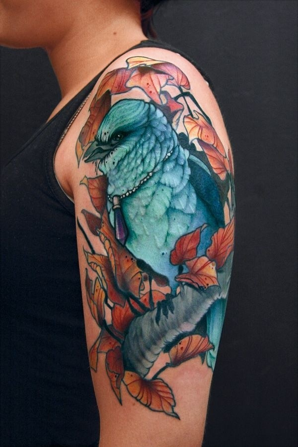 Lovely Aqua Bird Sitting On Tree Tattoo For Upper Arm