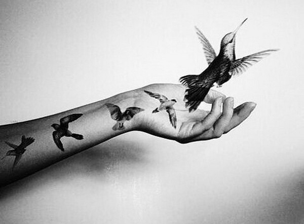 Lovely Flying Hummingbird Tattoo For Girl Arm