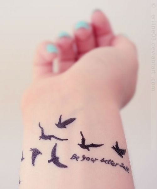 Marvelous Black Flying Bird With Quote Tattoo On Girl Wrist
