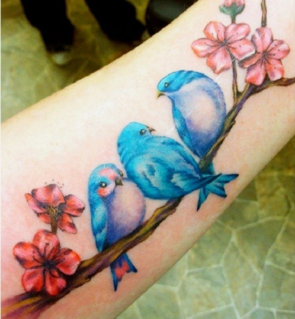 Nice Blue Bird And Red Flower Tattoo On Girl Sleeve