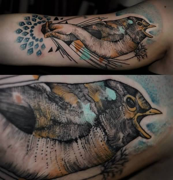 Nice Collaboration Of Bird And Human Hand Tattoo On Men Sleeve