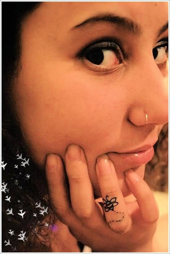 Small Baby Bee Black Tattoo On Ring Finger