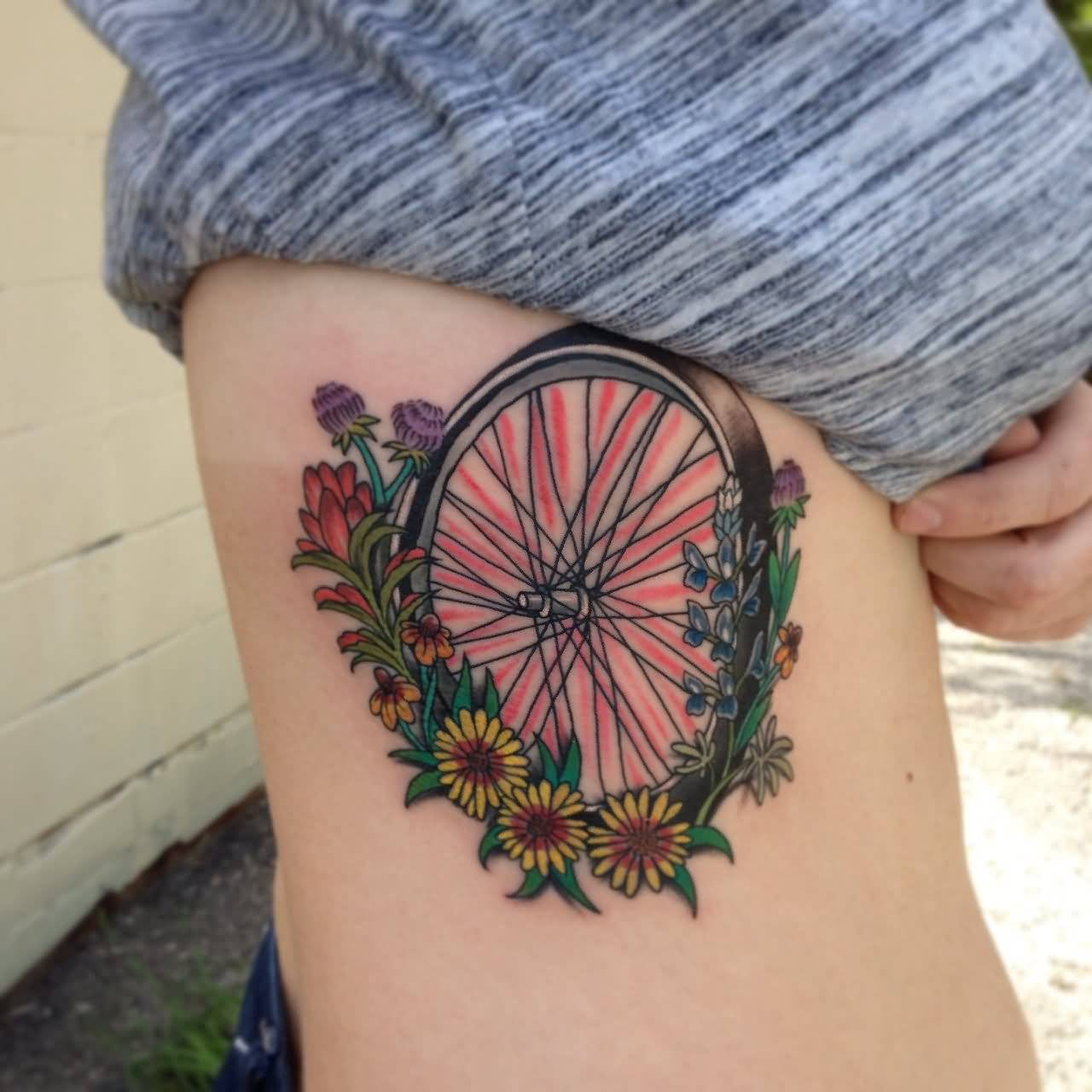Ultimate Bicycle Wheel And Flower Tattoo On Girl Ribs Side