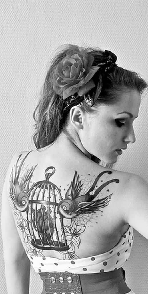 Women Back Decorated With Amazing Swallow Bird And Cage Tattoo