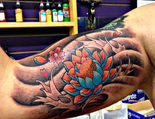 Wonderful Colorful Ink Asian Flower Bicep Tattoo For Men