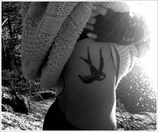 Wonderful Flying Swallow Bird Tattoo For Women Ribs
