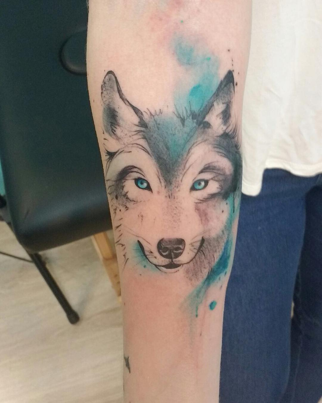 Amazing Wild Wolf With Blue Eye Tattoo On Men Sleeve