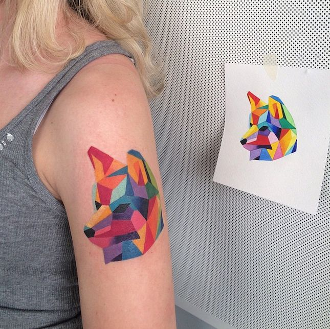 Nice Geometric Wolf Head Tattoo On Upper Arm
