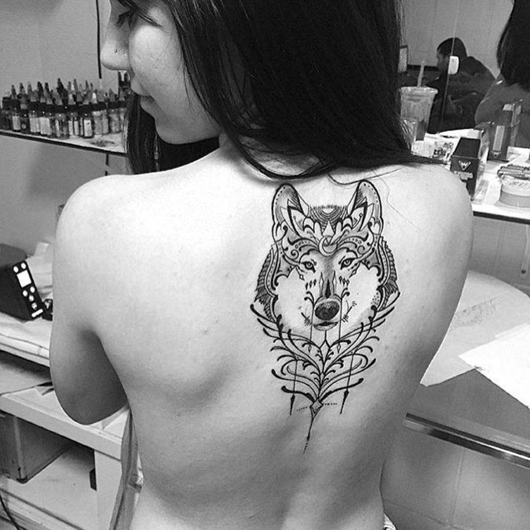Wonderful Black Ink Wolf Tattoo On Girl Back